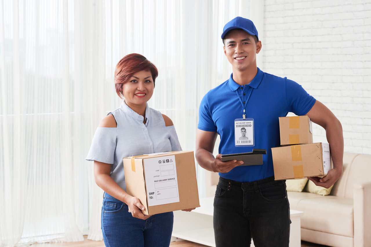 Simling fast delivery service representative and happy client