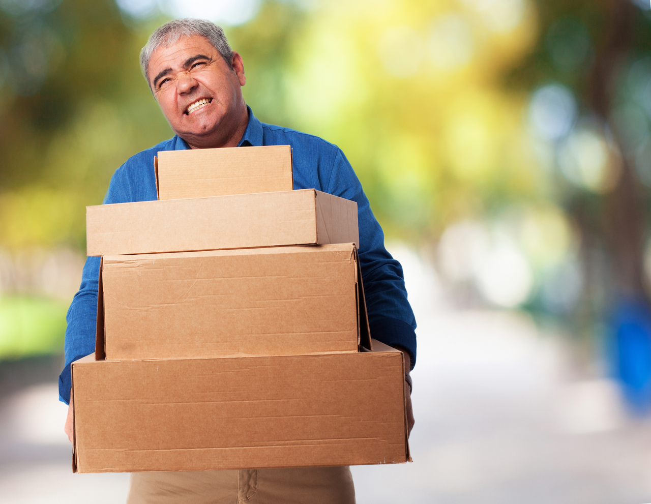man with heavy boxes