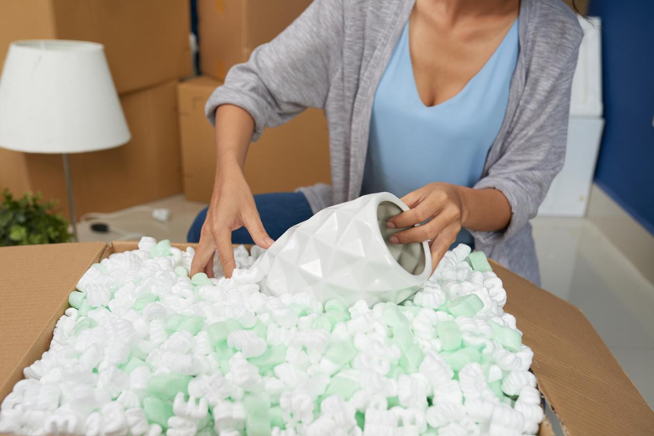 Woman Unpacking Vase