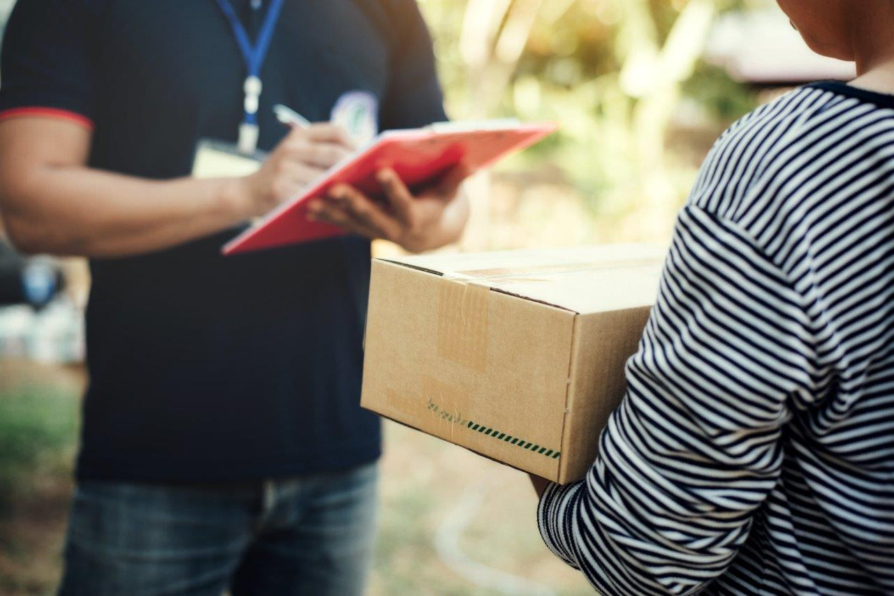 woman receiving package from man