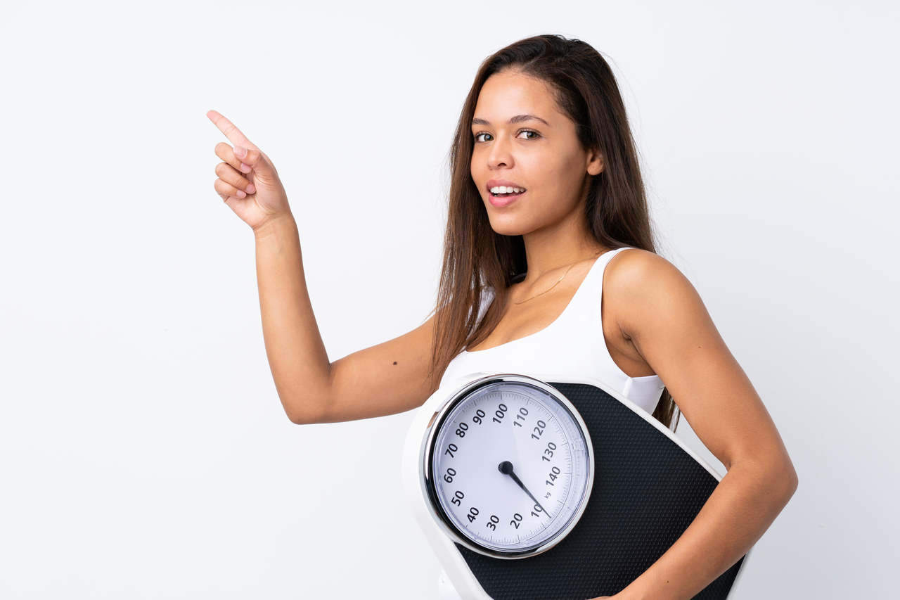 girl holding a scale