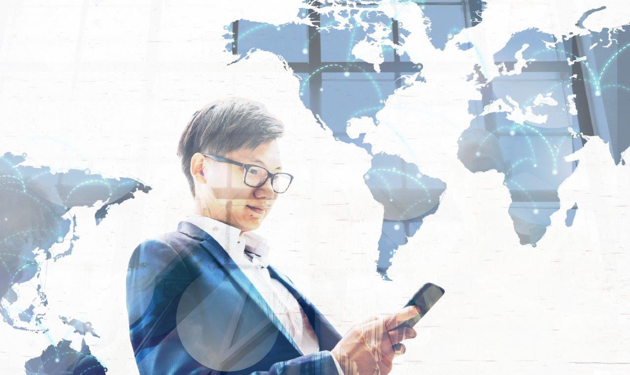 man looking at phone with world map overlay