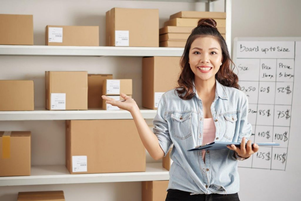 woman in front of shelves of boxes