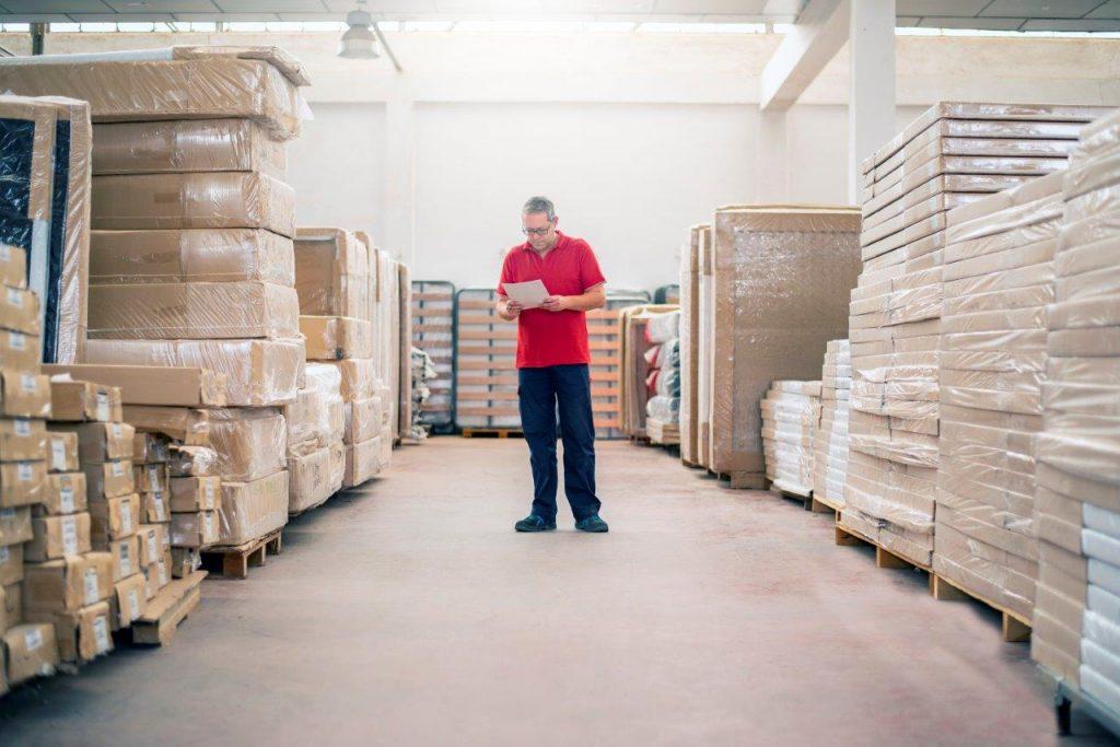 man checking inventory