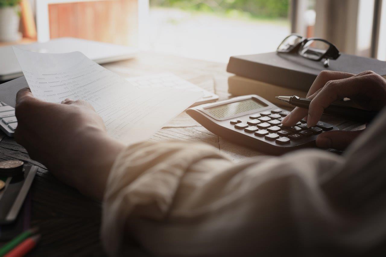 person calculating savings