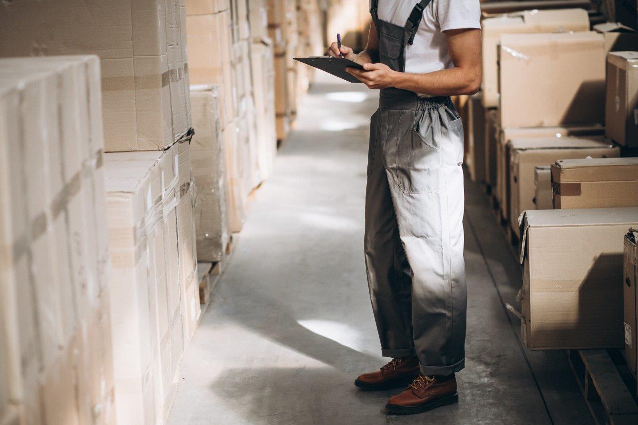 man checking warehouse inventory