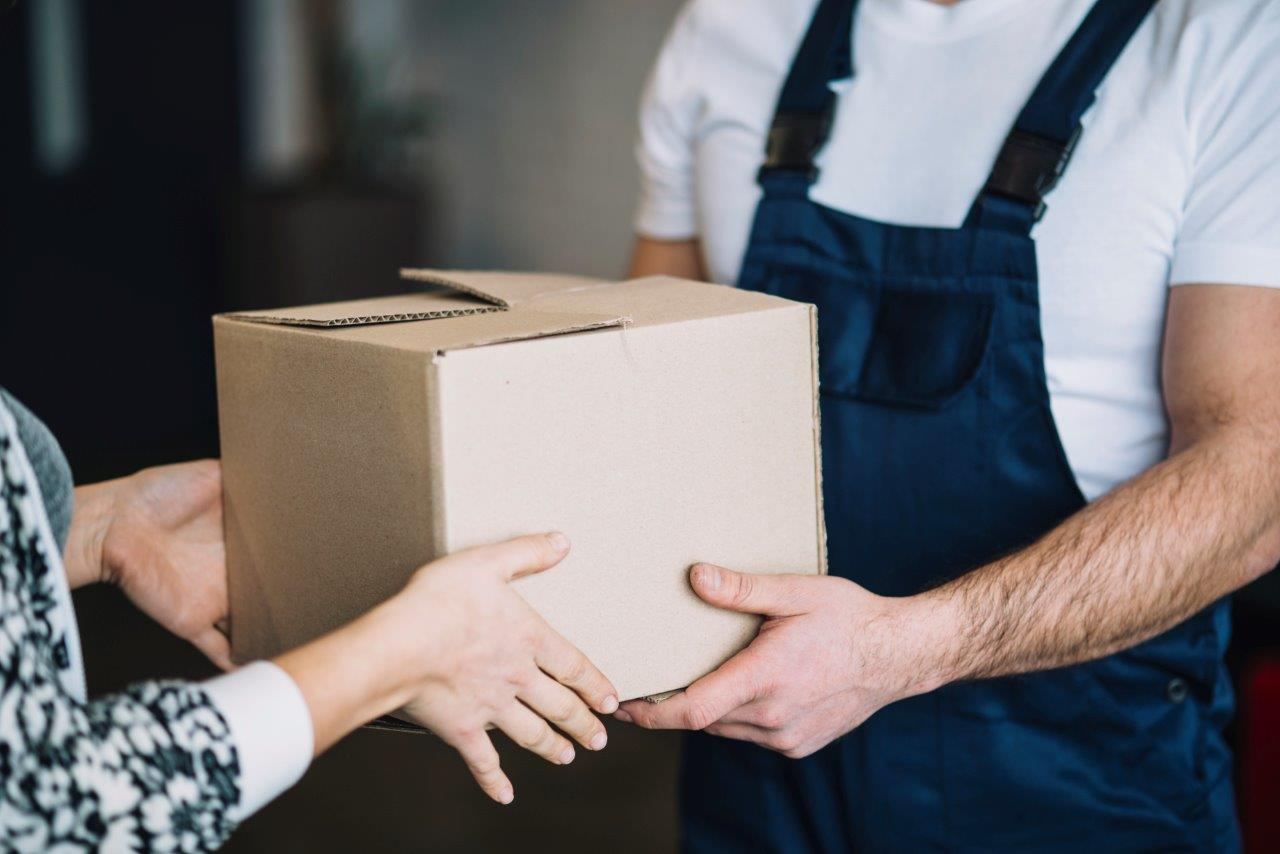 woman receiving delivery man's package