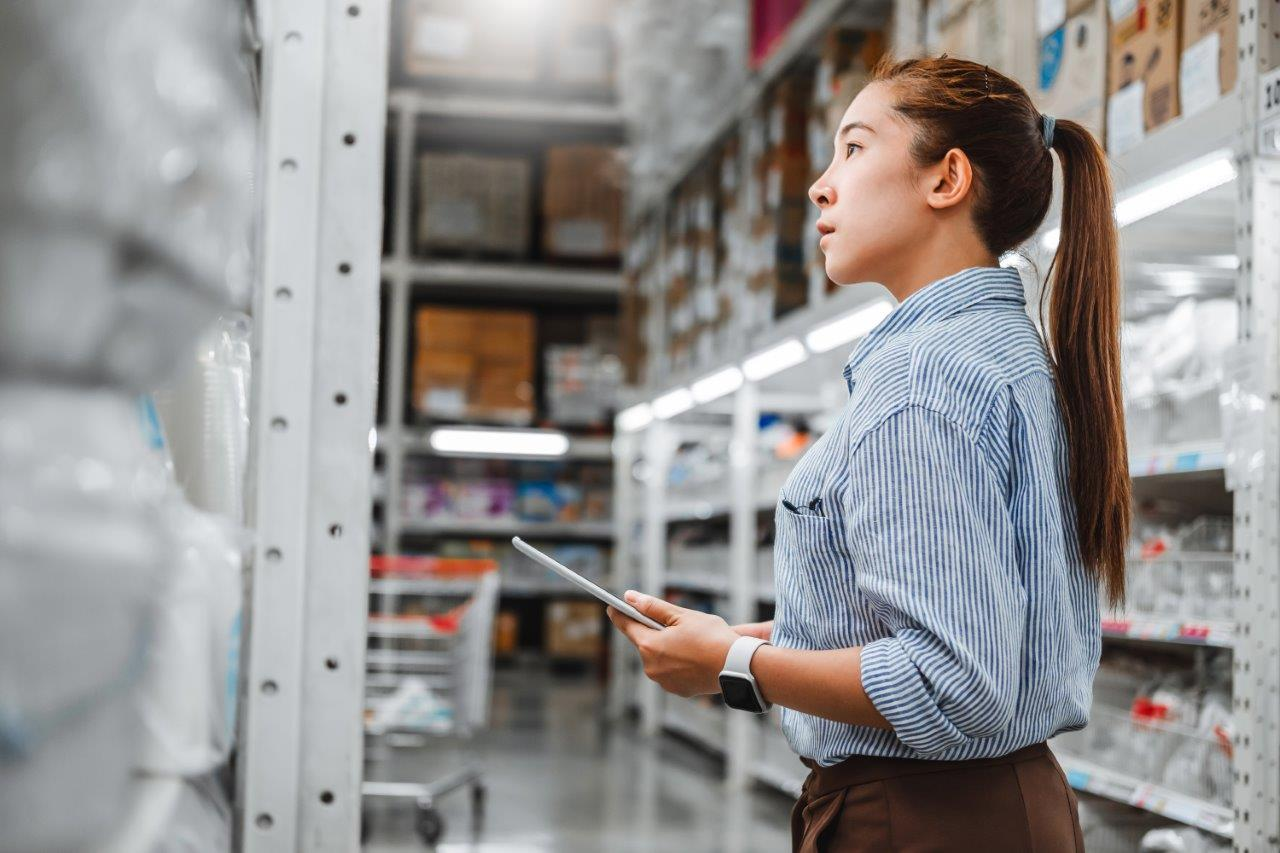woman inspecting warehouse