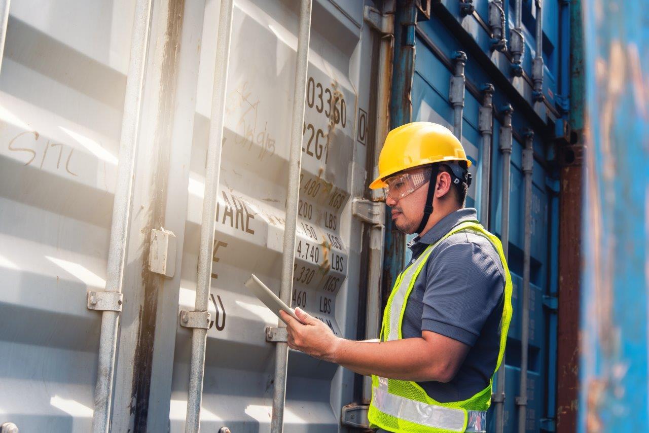 man inspecting container van