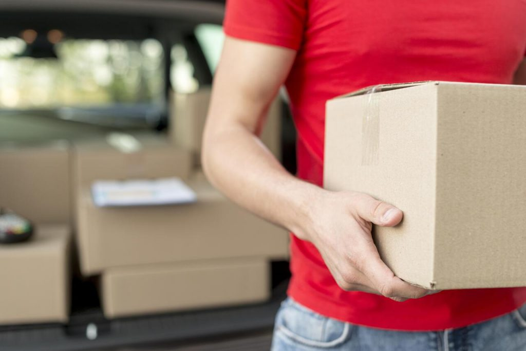 Close up of a delivery man holding a package