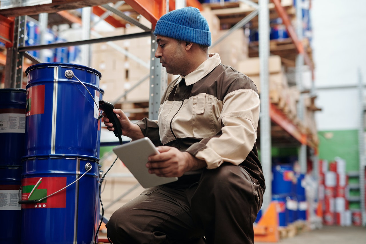 A man using a verification system at a warehouse