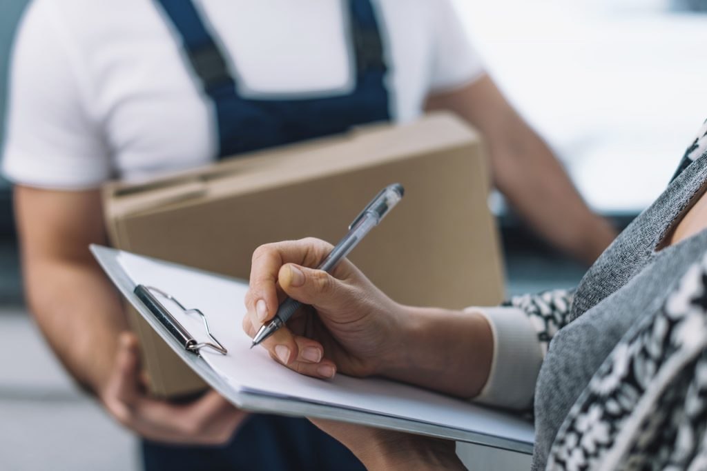 A woman signing an order fulfillment form