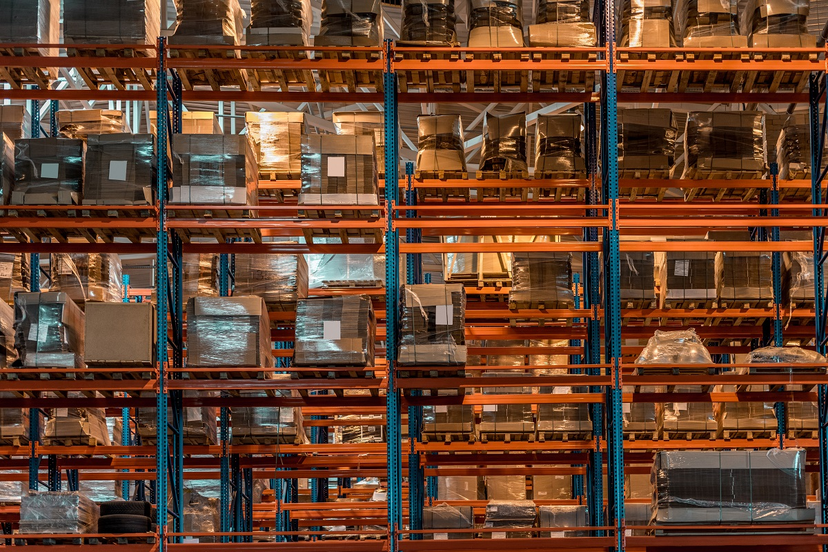 boxes and containers on shelves in modern warehouse