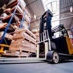 Forklift loader in storage warehouse ship yard. Distribution products. Delivery. Logistics. Transportation.