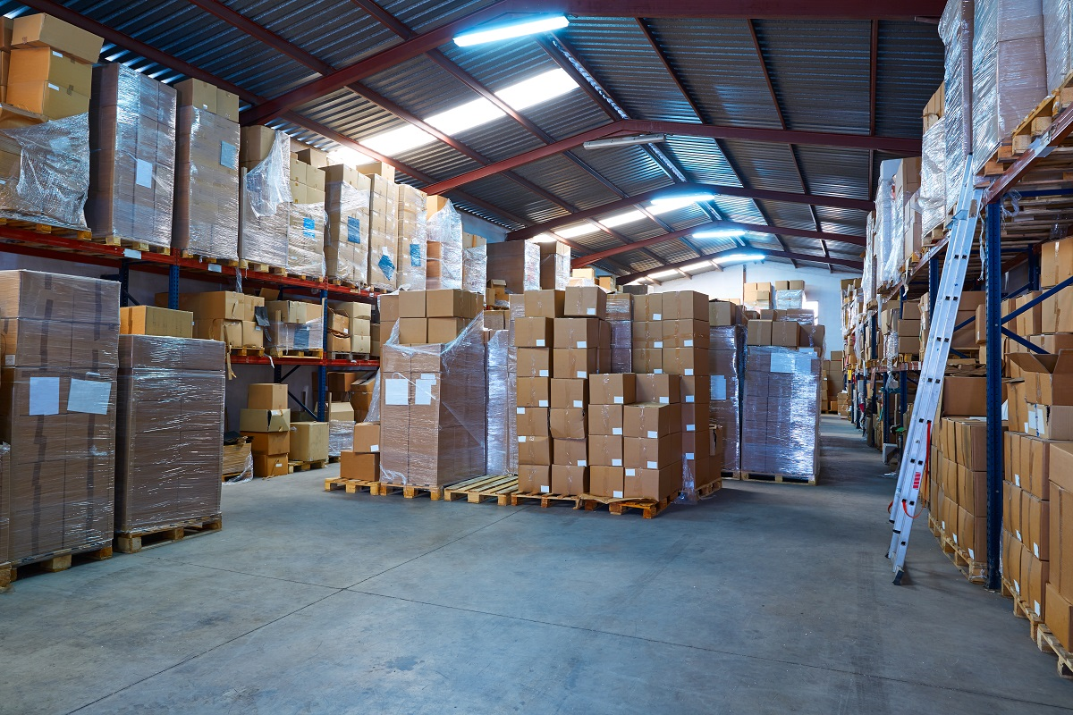 Warehouse stograge with stacked boxes in rows