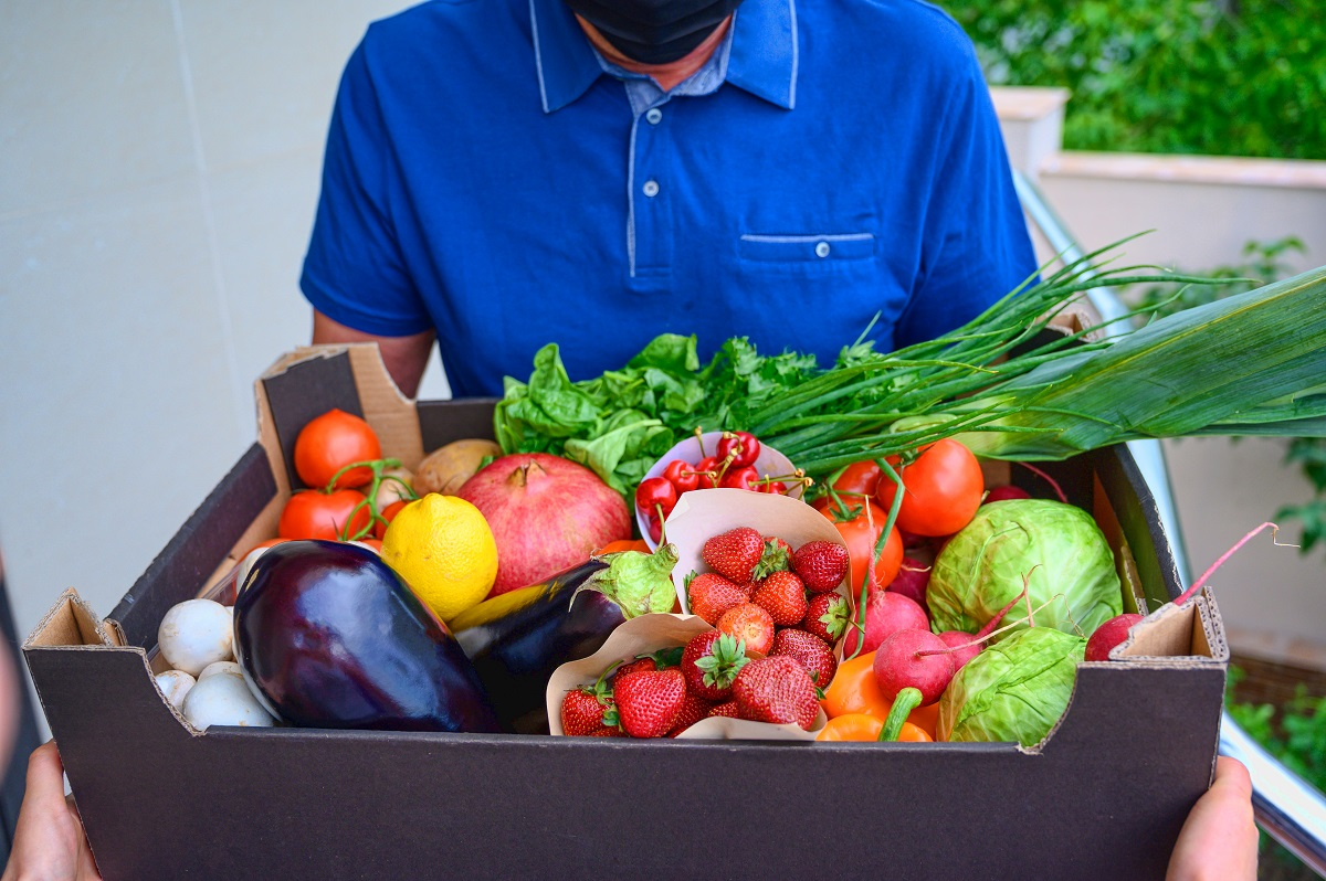 Box full of fruits and vegetables. Eggplant, mushrooms, cabbage and strawberry. Fresh organic farm products